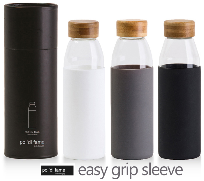 This stylish Glass Drink Bottle has a silcone grip around the bottle that makes handling easy! 500ml high borosilicate glass body, bespoke natural bamboo leak proof lid. Supplied in a black po 'di fame presentation tube with logo laser engraving service available. Colours: Black, Grey, White. Corporate Sales FreeCall 1800 654 990